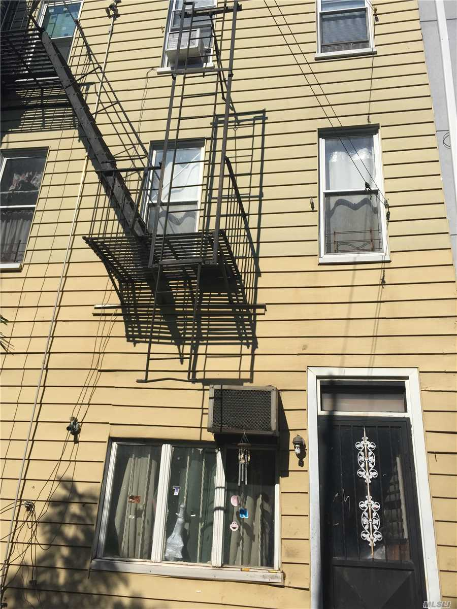 Photo of home for sale at 18-18 Palmetto St, Ridgewood NY