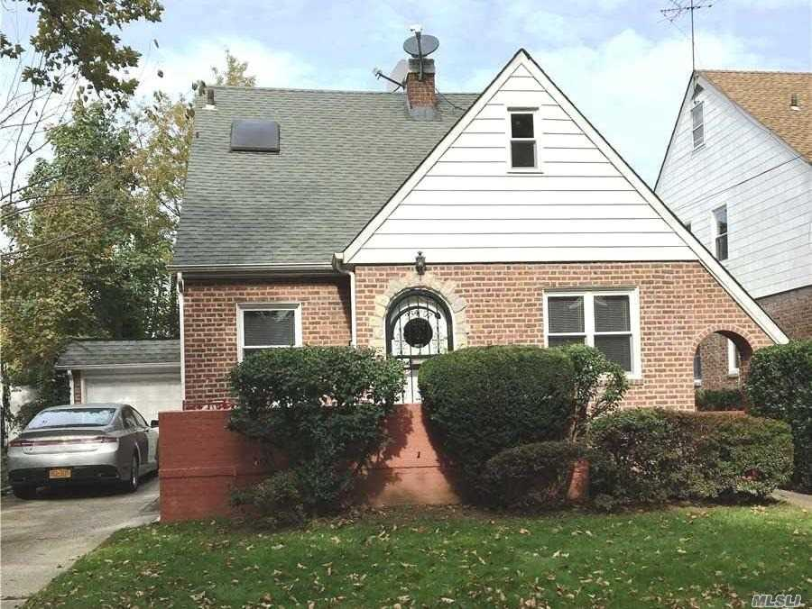Photo of home for sale at 234-07 Seward Ave, Bellerose Manor NY