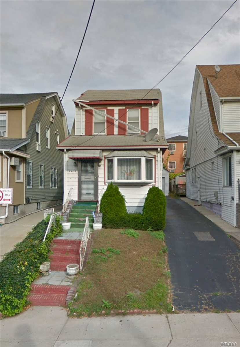 Photo of home for sale at 84-25 168th Pl, Jamaica NY