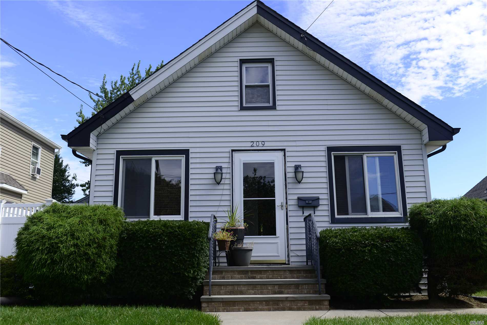 Photo of home for sale at 209 Moody Ave, Freeport NY