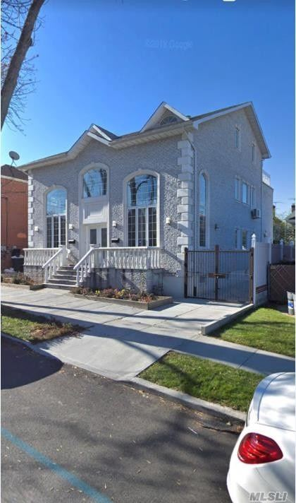Photo of home for sale at 11-22 128 St, College Point NY