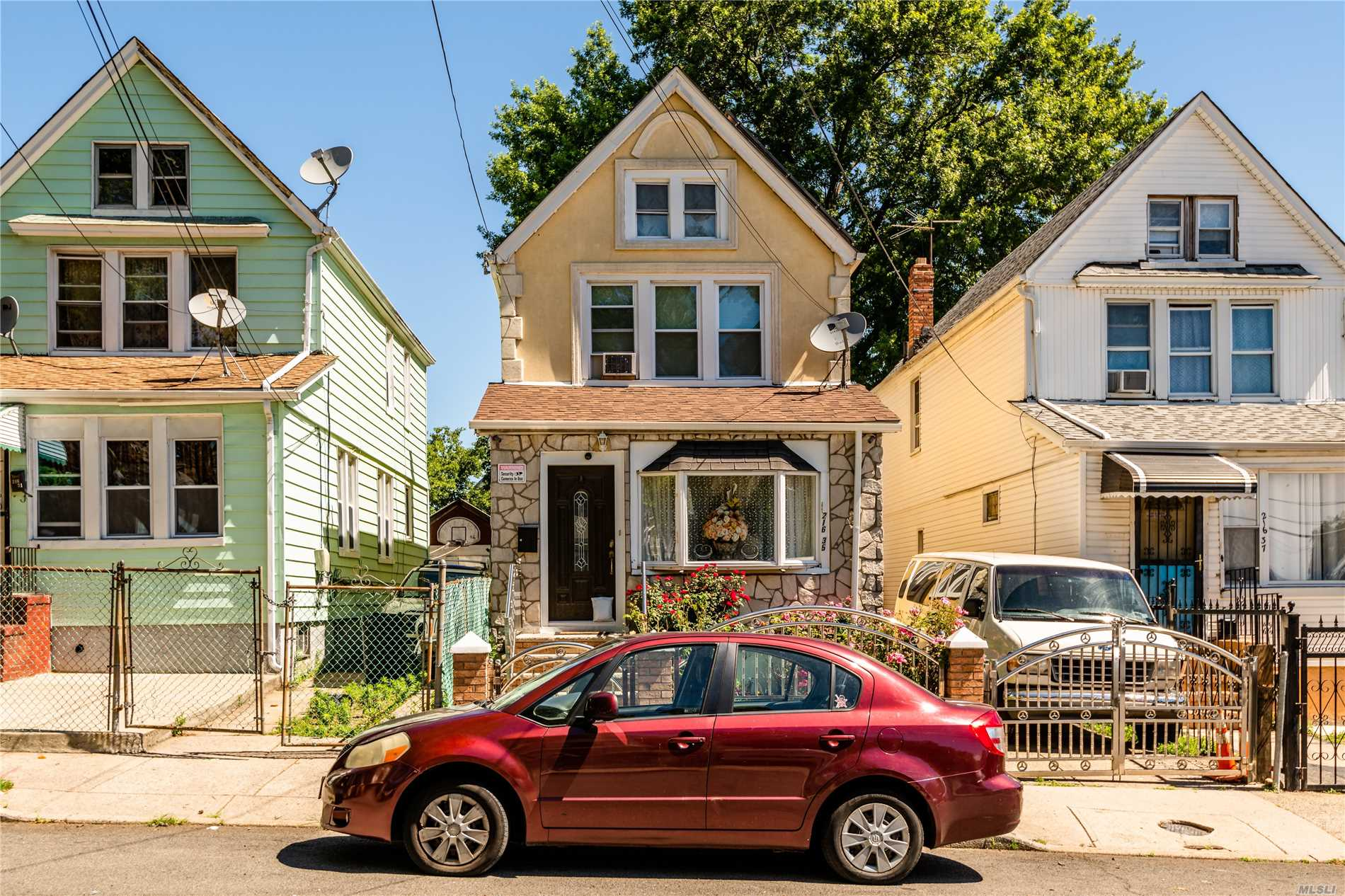 Photo of home for sale at 216- 35 111 Ave, Queens Village NY
