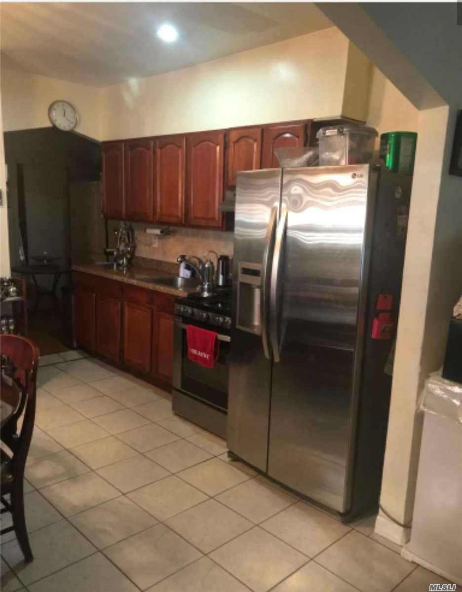 Photo of home for sale at 32-15 110th St, East Elmhurst NY