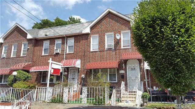 Photo of home for sale at 25-15 97 St, East Elmhurst NY