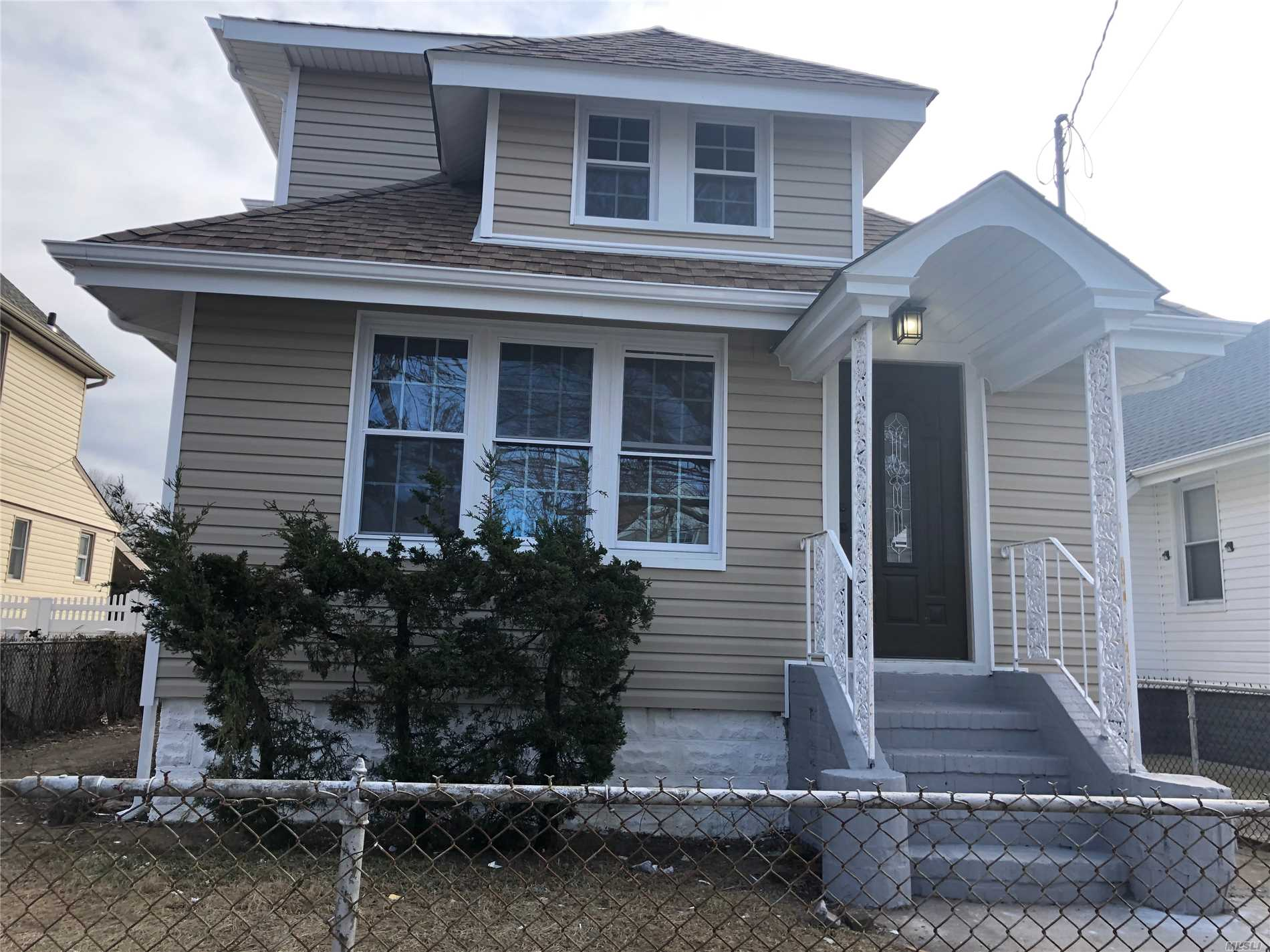 Photo of home for sale at 136-23 242 St, Rosedale NY