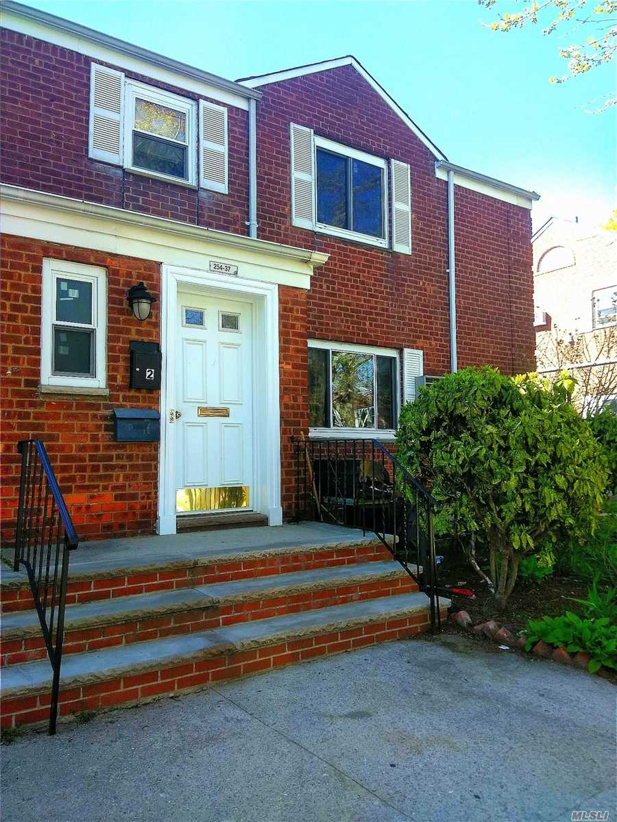 Photo of home for sale at 254-37 75 Ave, Glen Oaks NY