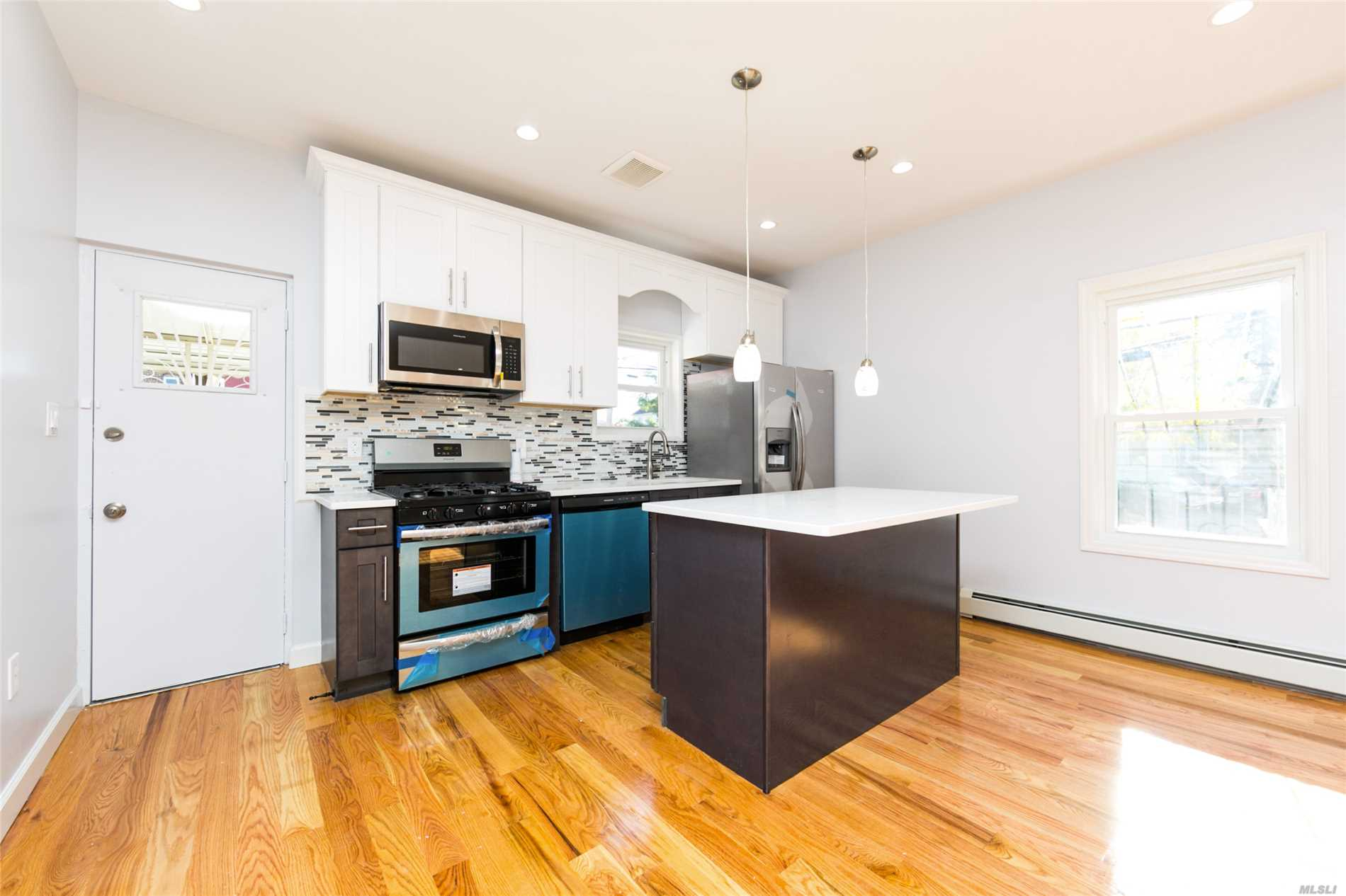 Photo of home for sale at 115-73 203rd St, St. Albans NY