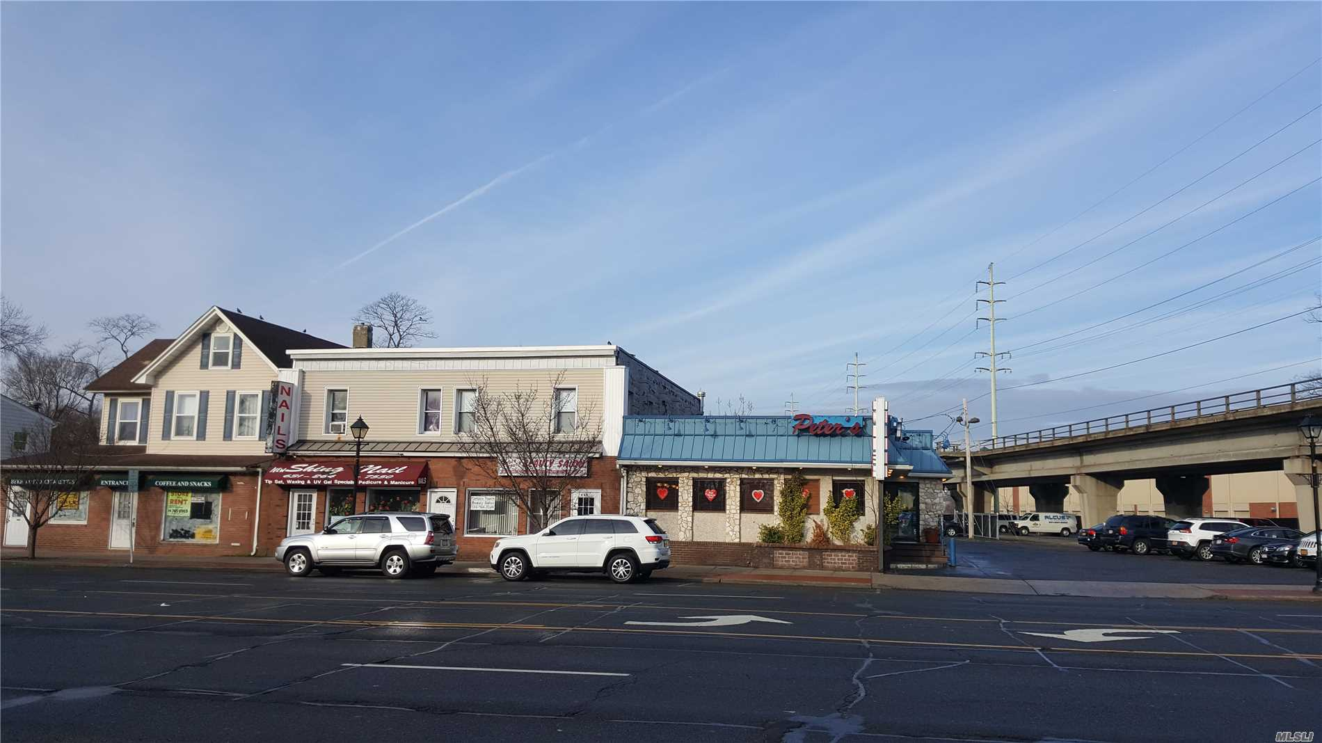 Photo of home for sale at 232-236 Broadway, Amityville NY