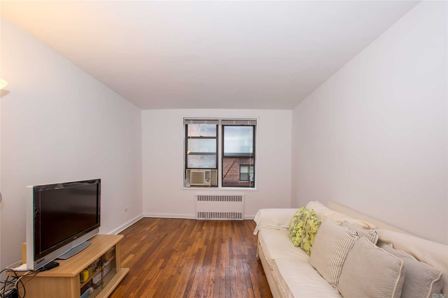 Photo of home for sale at 103-25 68th Ave, Forest Hills NY