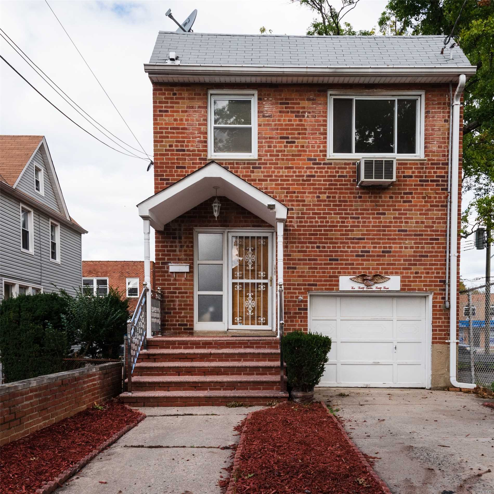 Photo of home for sale at 237-33 Davenport Ave, Bellerose NY