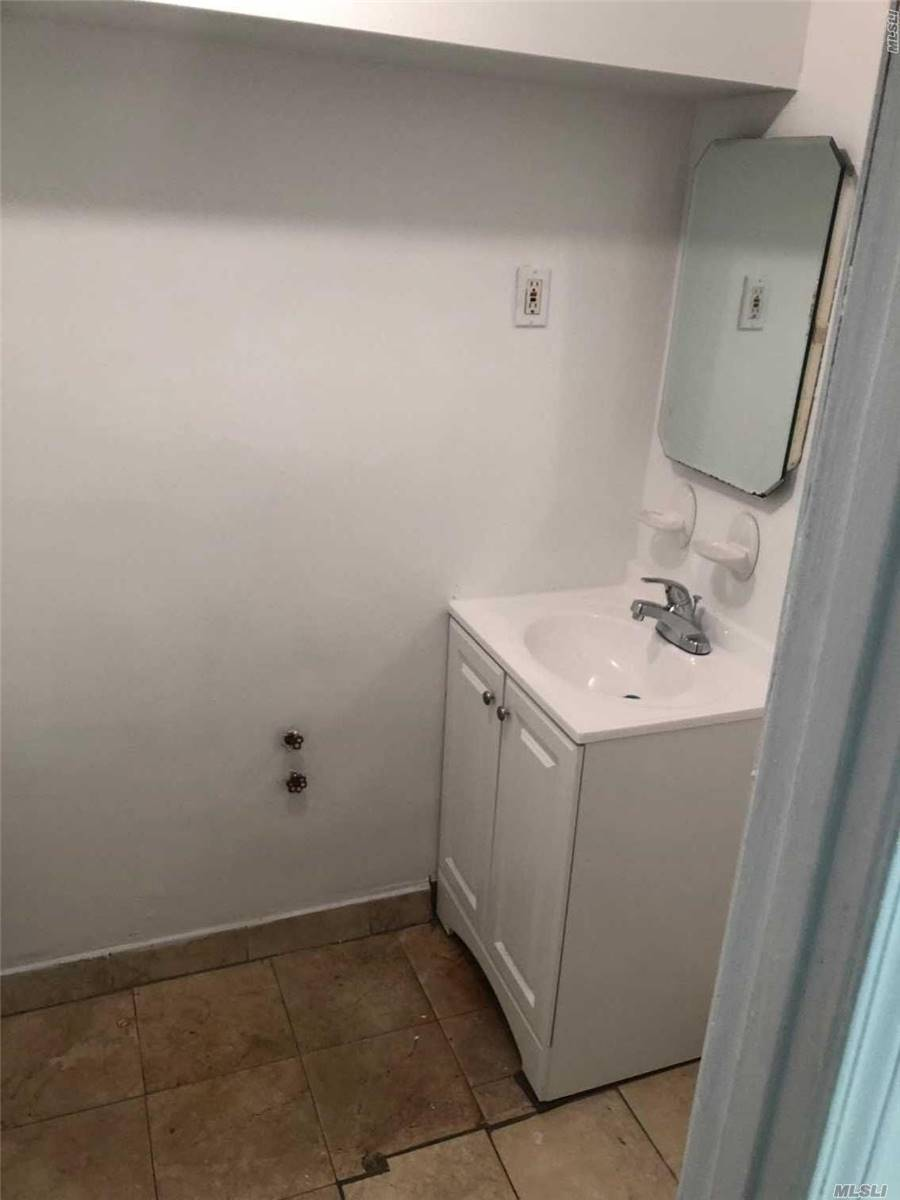 Photo of home for sale at 160-05 46th Ave E, Flushing NY