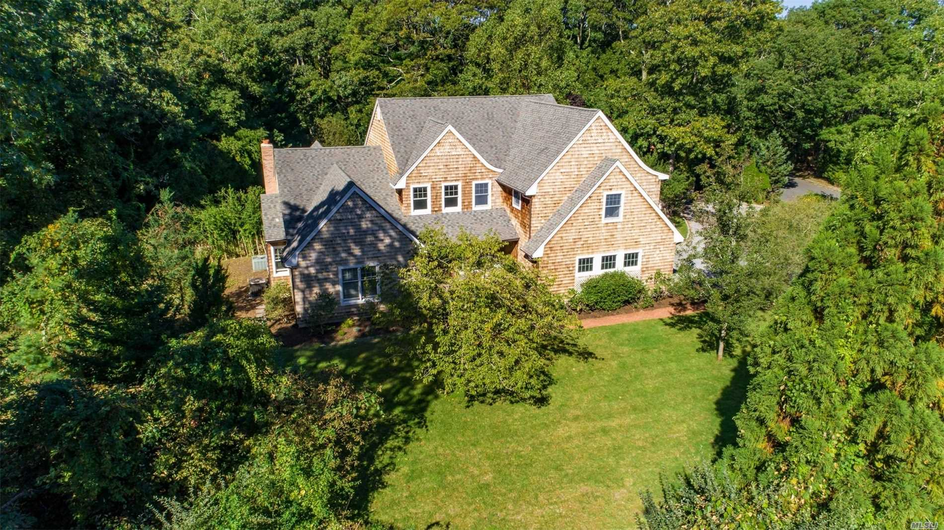 Photo of home for sale at 6 Bay Woods Dr, Hampton Bays NY