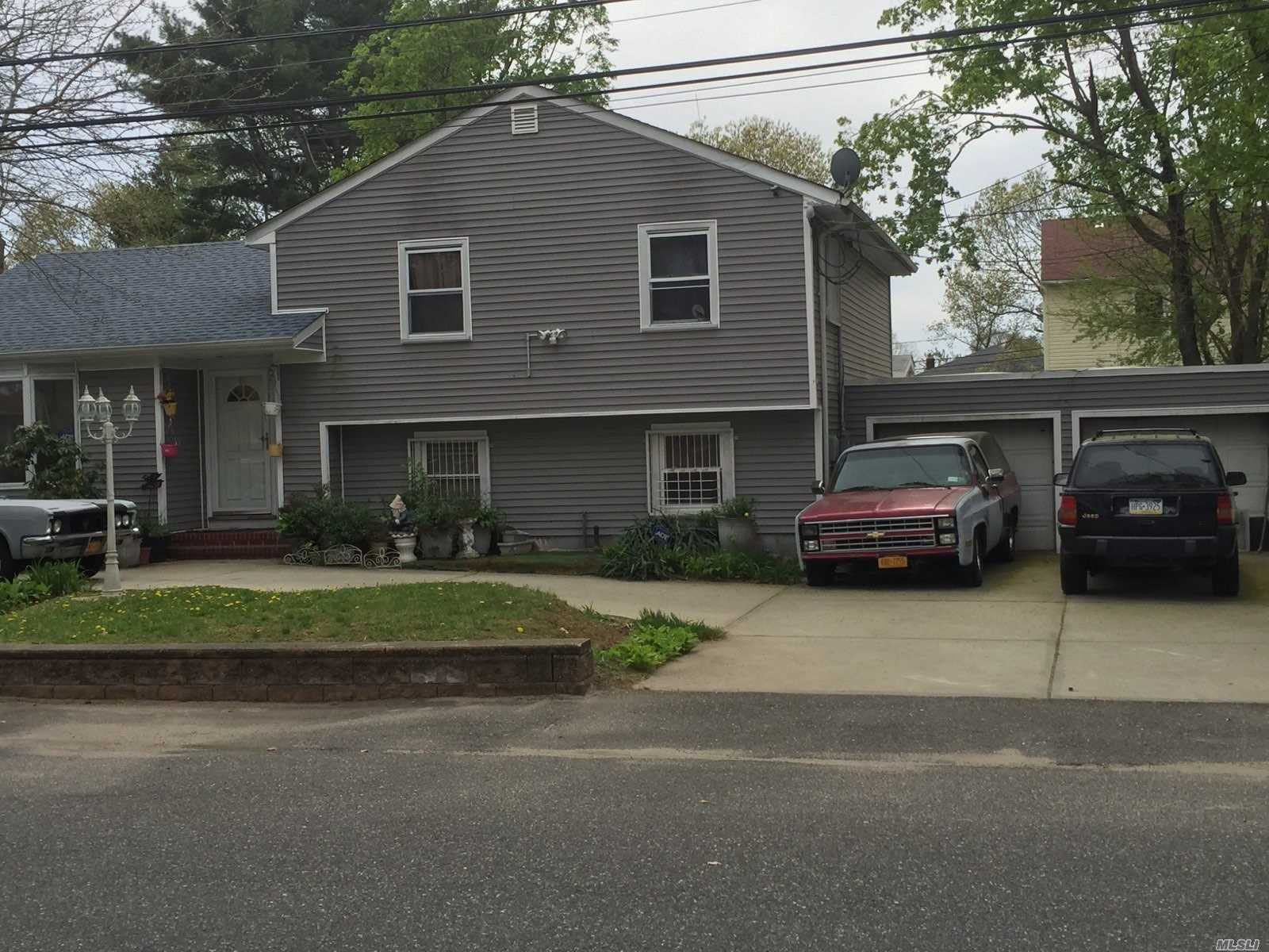 Photo of home for sale at 166 24th St N, Wyandanch NY