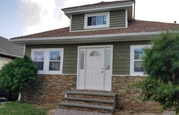 Photo of home for sale at 21 Ronald Pl, Roosevelt NY