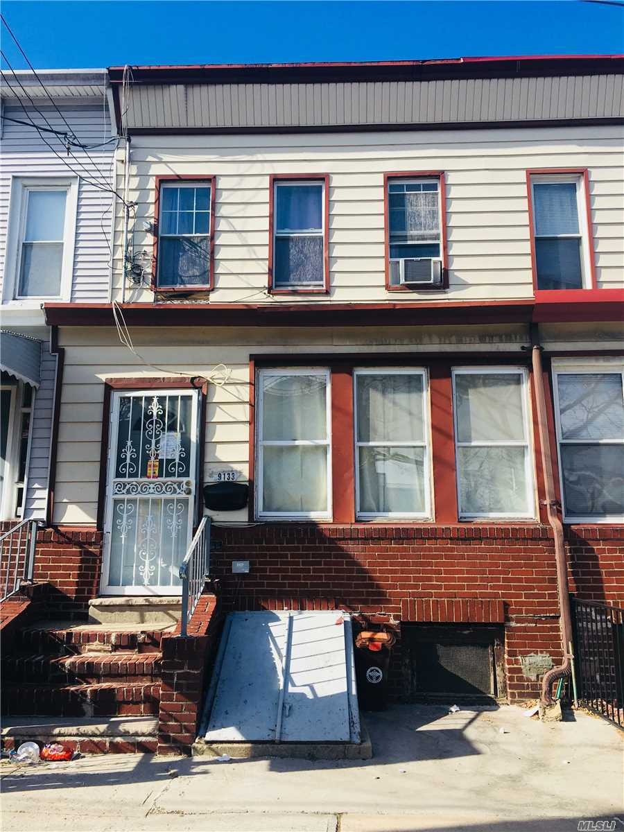Photo of home for sale at 91-33 88th Ave, Woodhaven NY
