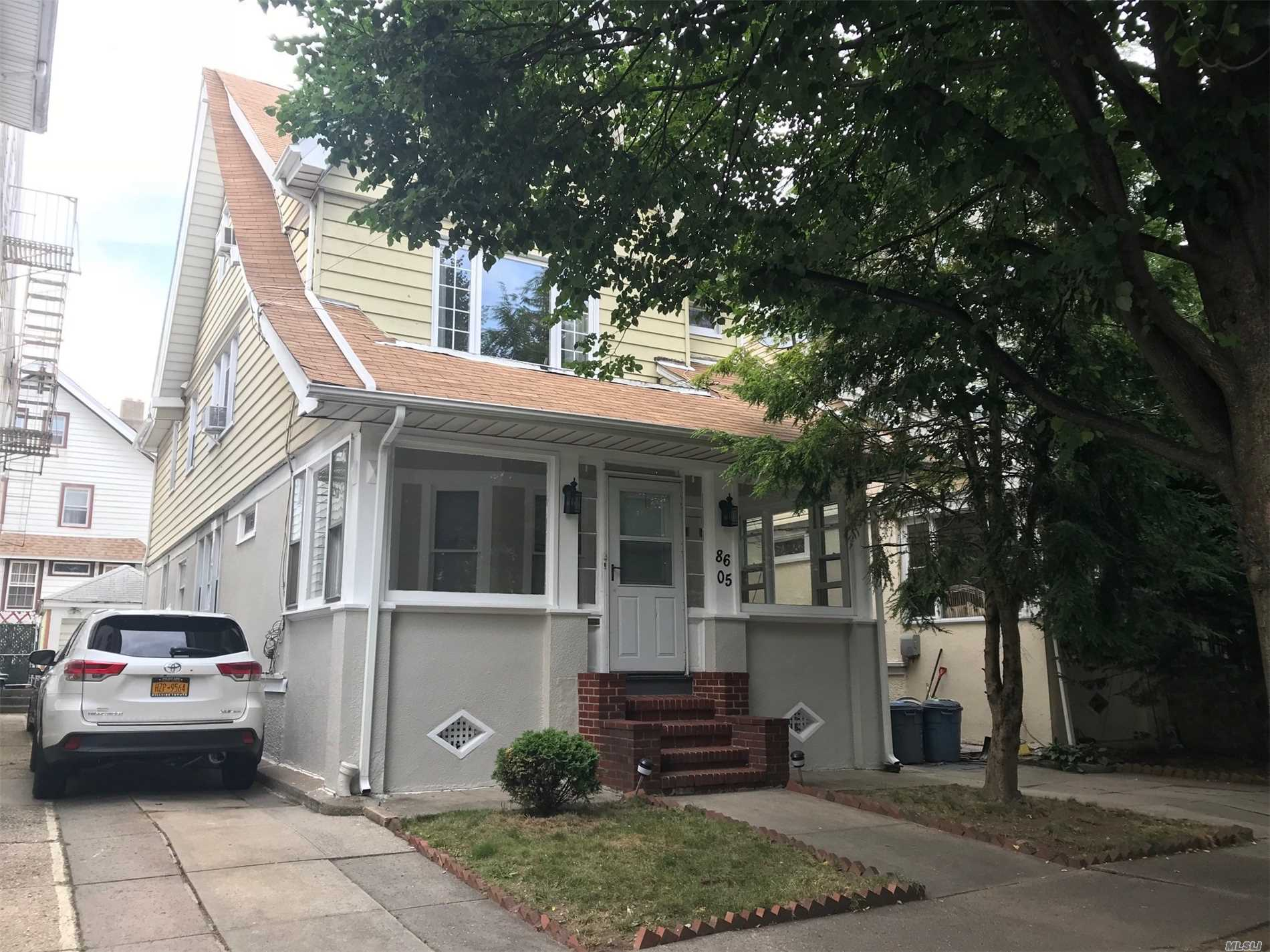Photo of home for sale at 86-05 86th Ave, Woodhaven NY