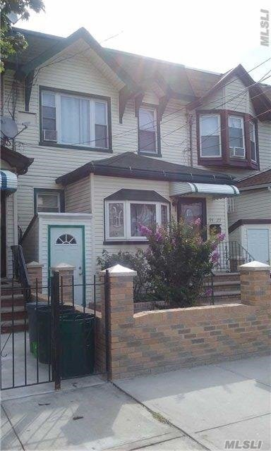 Photo of home for sale at 94-25 76th St, Ozone Park NY