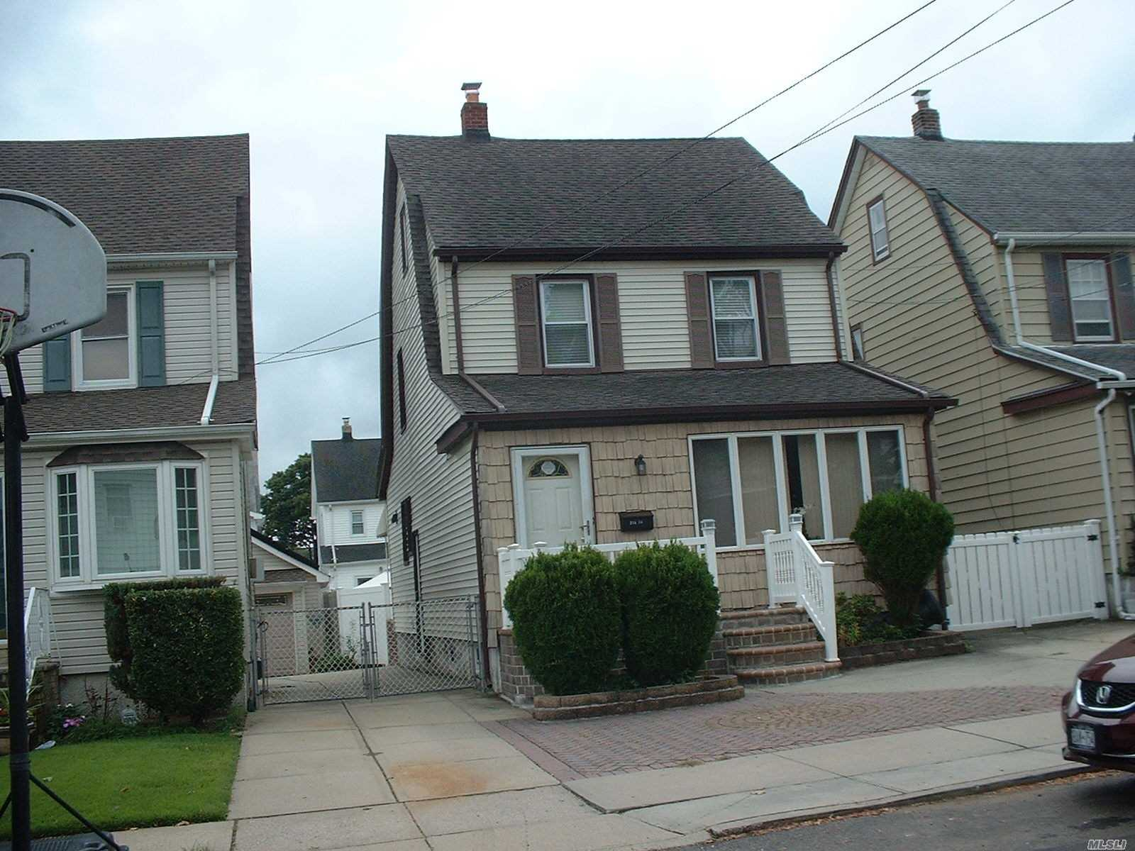 Photo of home for sale at 248-54 88th Dr, Bellerose NY
