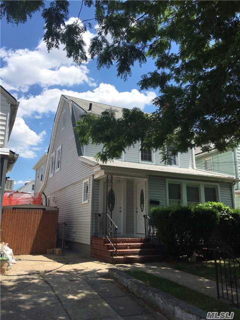 Photo of home for sale at 11317 200th St, St. Albans NY
