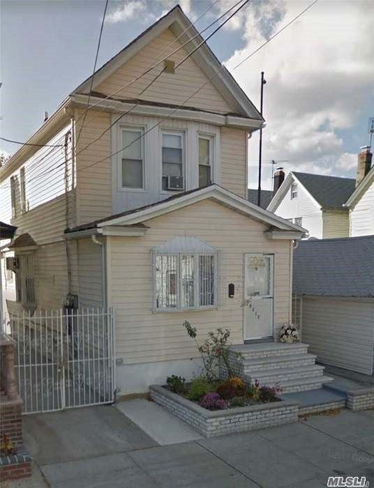 Photo of home for sale at 103-12 107th St, Ozone Park NY