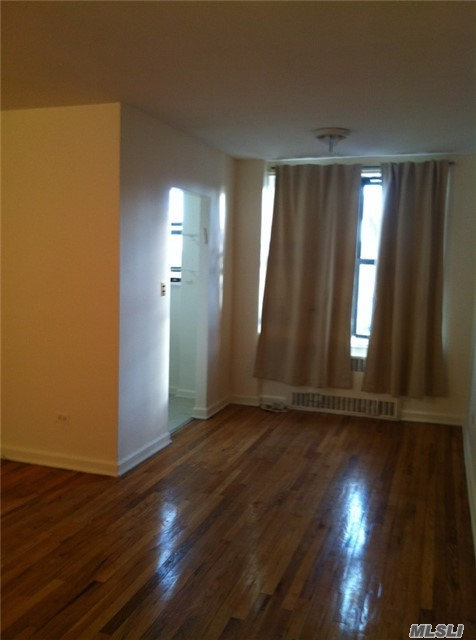 Photo of home for sale at 67-30 Dartmouth, Forest Hills NY