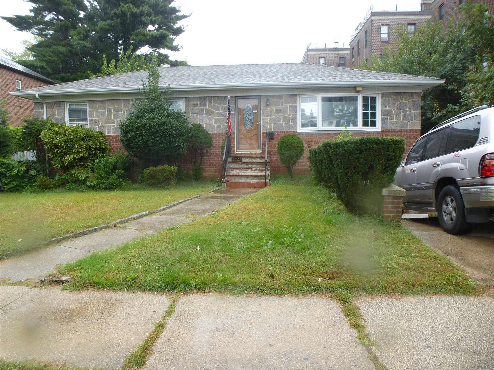 Photo of home for sale at 35-77 163rd St, Flushing NY