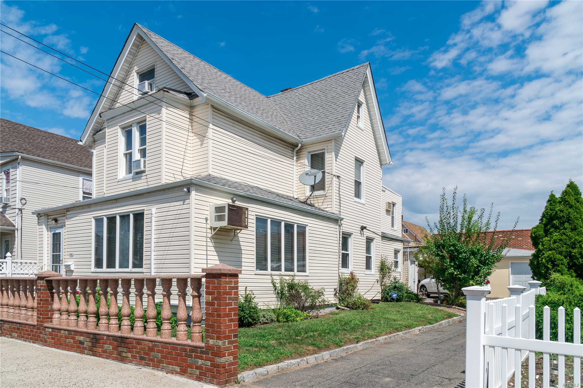 Photo of home for sale at 99-05 98th St, Ozone Park NY