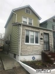 Photo of home for sale at 130-13 135 Pl, South Ozone Park NY