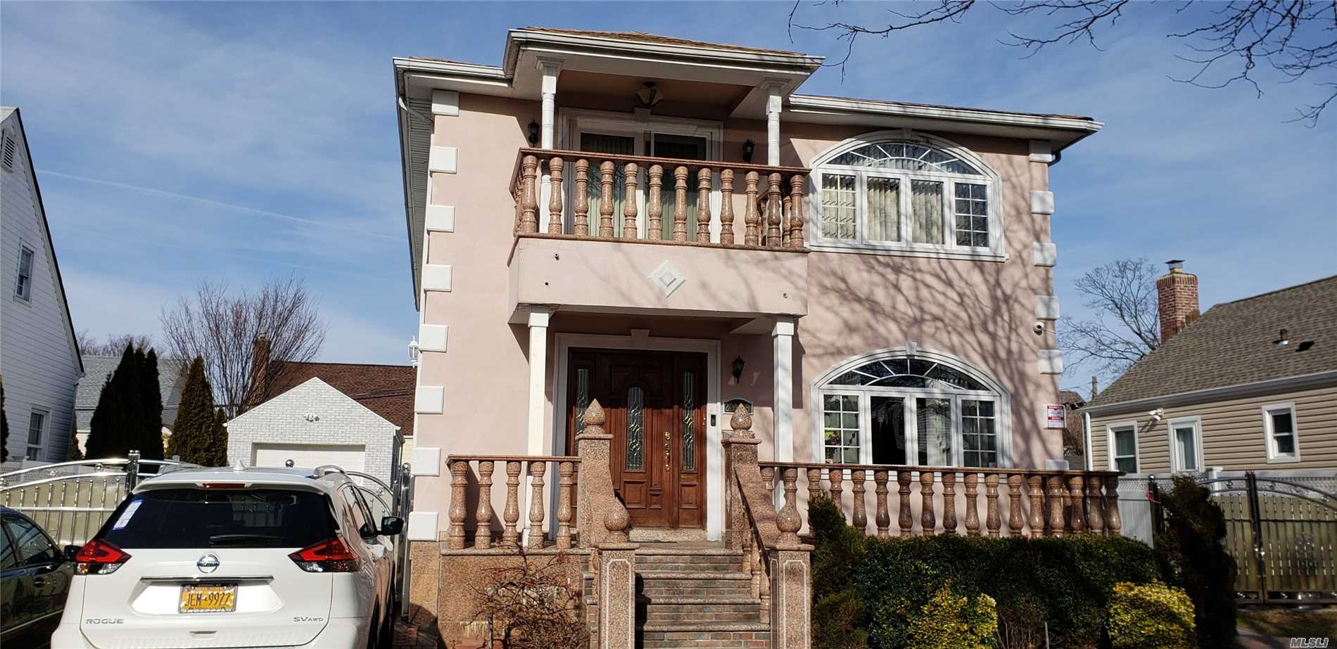 Photo of home for sale at 246-65 87th Ave, Bellerose NY