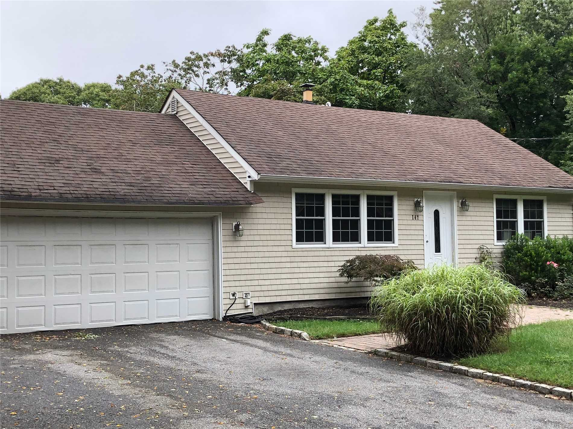 Photo of home for sale at 147 Mark Tree Rd, Centereach NY