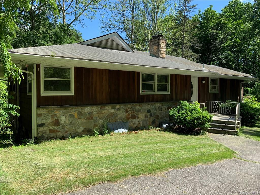 Situated on 1.27 acres, this Continental Village property features a nicely sized two level home set