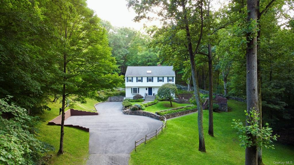 Extreme privacy in Briarcliff Manor's award winning school district! This rare gem is setback on 2.7