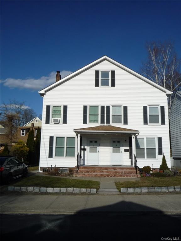 Pristine totally refreshed and updated 3 BR, 1/1/2 Bath, 2 level Colonial Duplex in Historic Distric