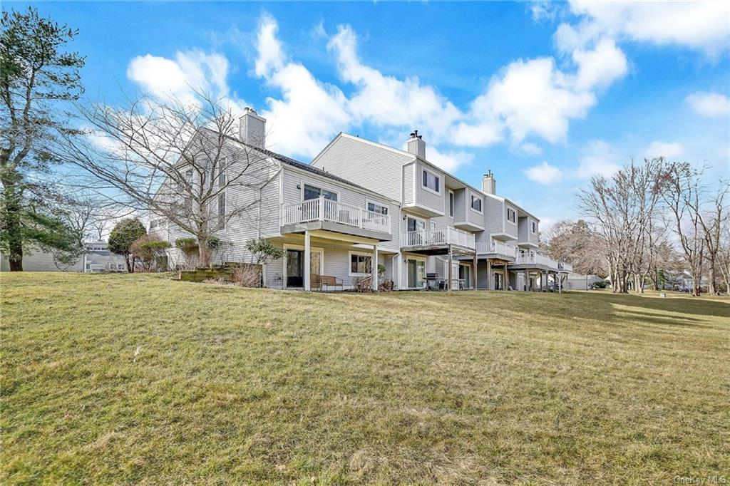 Enter this gem in Yorktown Heights to a view of the high ceilings and tall turning wood and iron sta