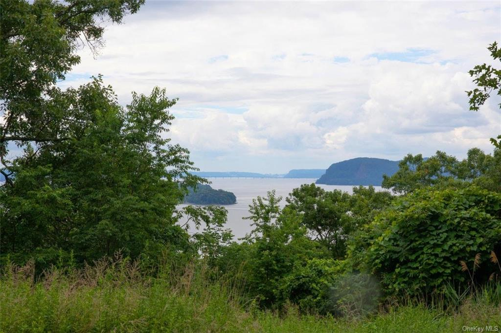 Opportunity to custom build on a desirable lot overlooking the Hudson. 1.1 Acres (vacant lot)  067.1