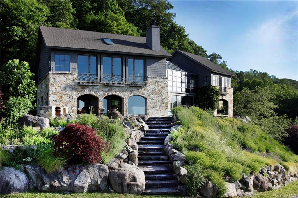 Nestled in the Hudson Valley just 50 miles from Manhattan, this unique and creative home is bathed i