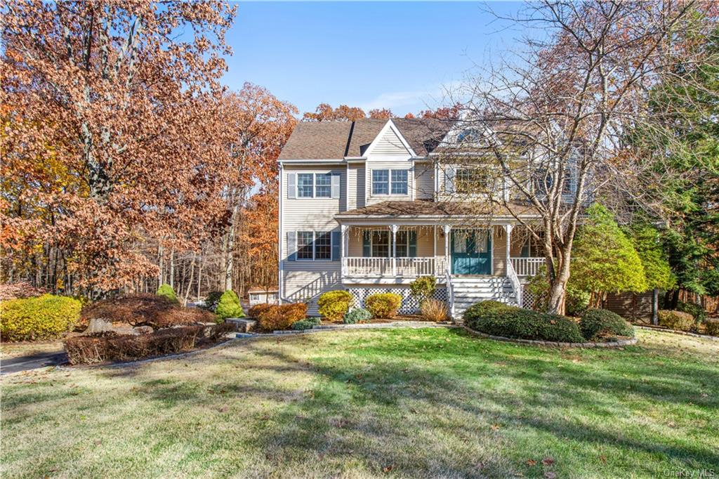 Center hall Colonial with rocking chair front porch situated at the end of a cul-de-sac! A welcoming