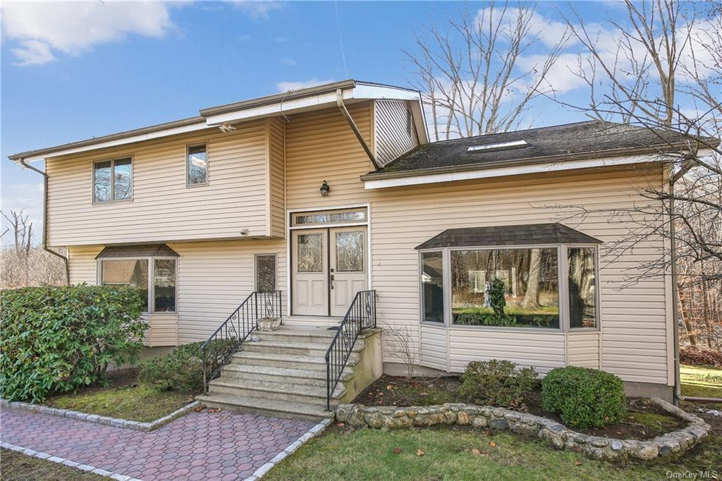 Set on a cul-de-sac in the Yorktown Central School District is this updated and renovated contempora