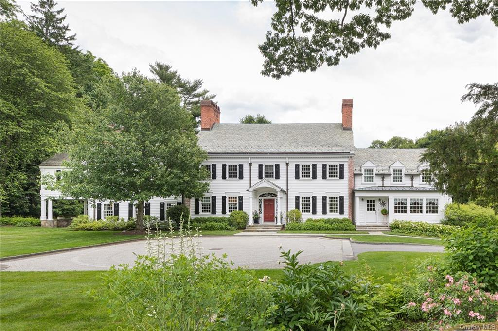 This gated country retreat includes a slate roofed colonial on 3.95 acres of beautifully maintained