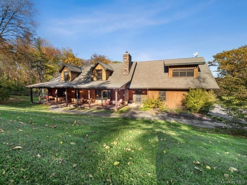 Stunning country setting for this gorgeous home and natural stone walkways and stone walls.  Split rail fences and mature shrubs
