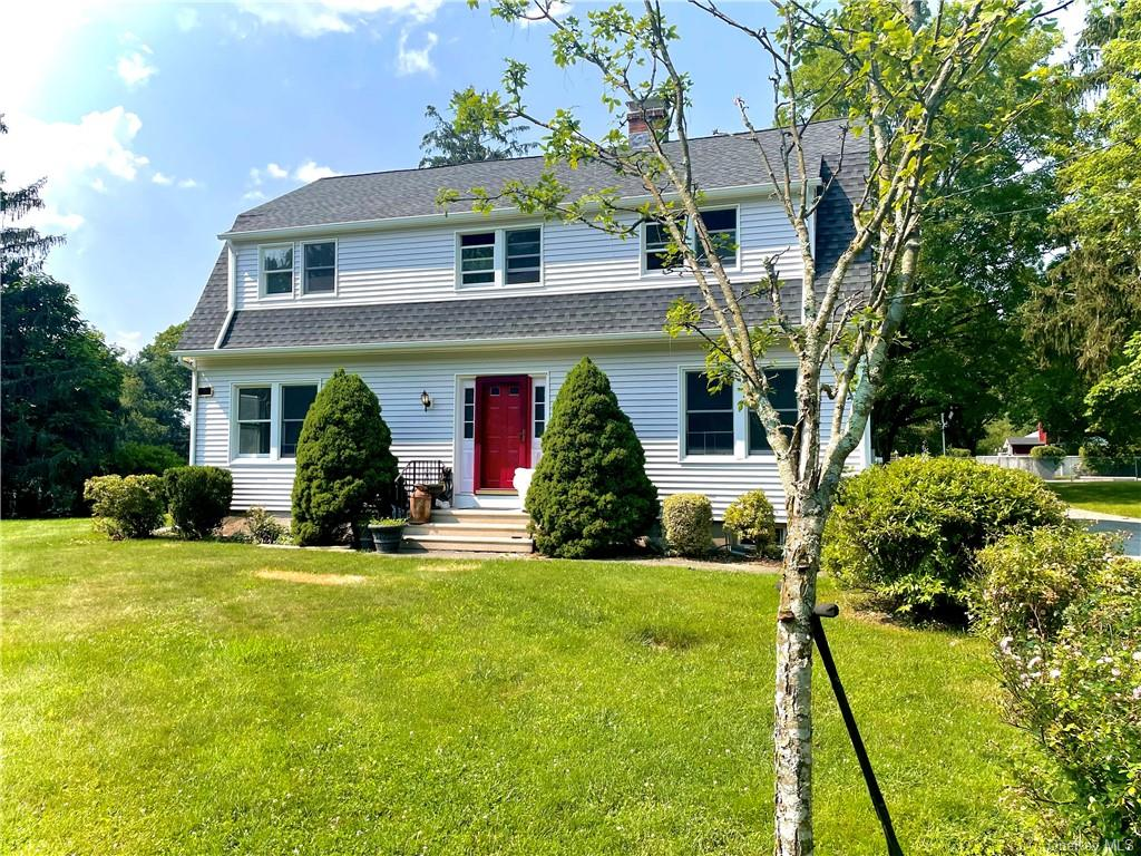 Well maintained Dutch Colonial perfectly sited on level acre in sought after neighborhood. Fabulous
