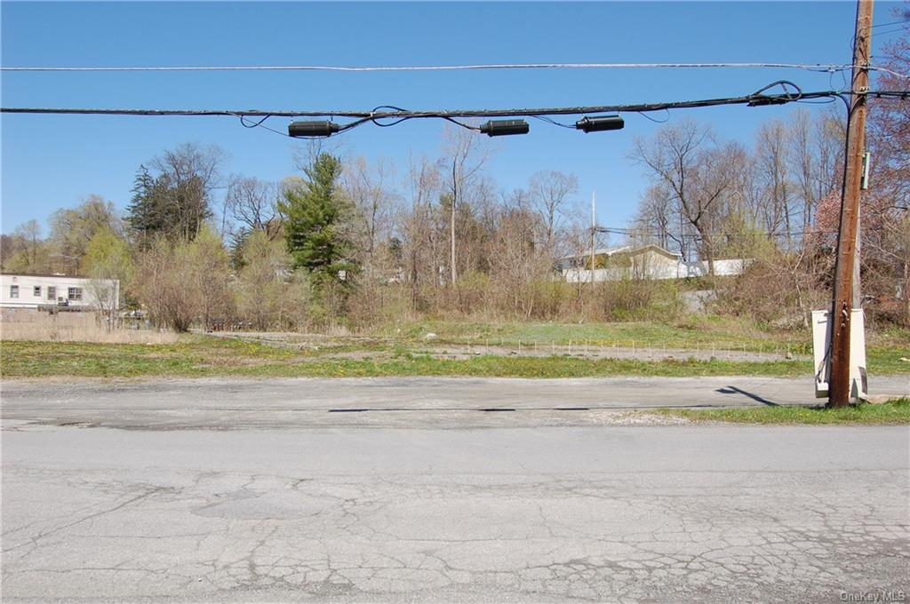 Flat, level acre with town sewer available