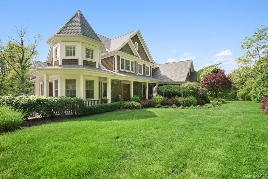 Experience the best of Hudson Valley living in this private 1.83-acre hilltop oasis just an hour fro