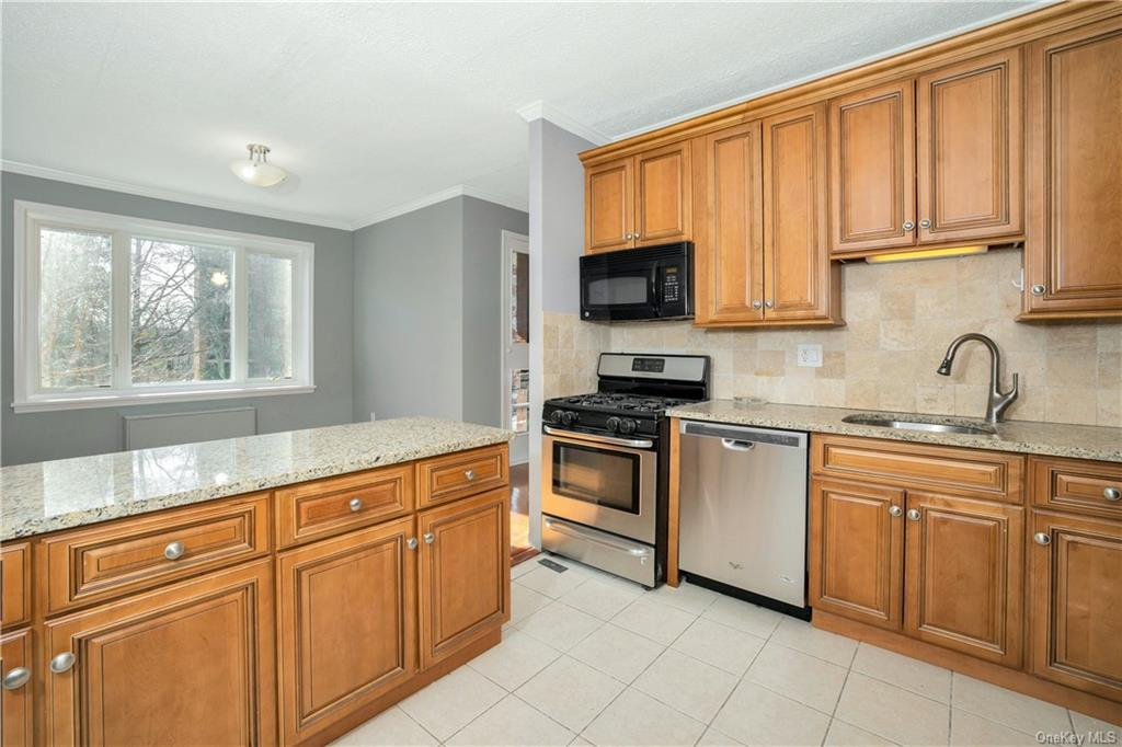 COMPLETELY UPDATED and in immaculate condition and ready for occupancy! Large rooms  with ample clos