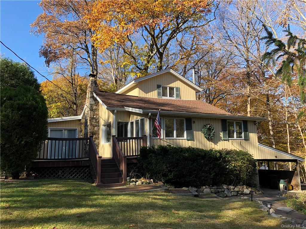 Surrounded by mature trees and situated on a raised  corner lot, sits this nicely laid out cape cod.