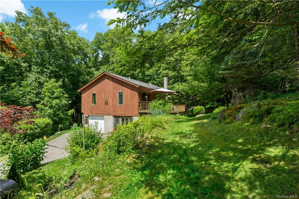 A long driveway introduces this wonderful hideaway home that is set back upon a hill with lots of pr