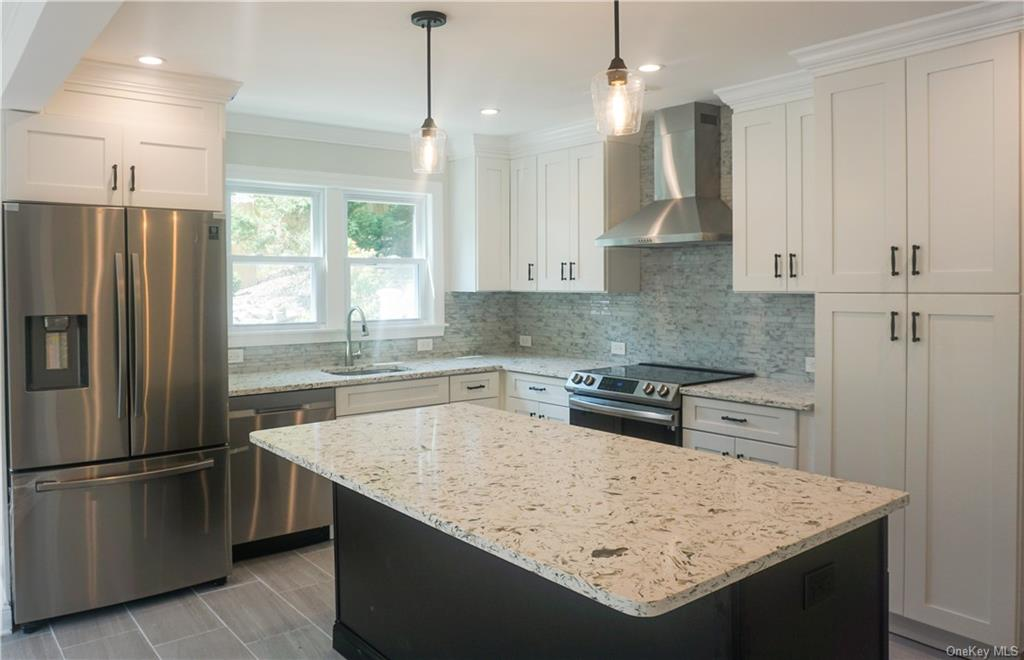 House is completely remodeled (2021) with New Main Floor:  Gourmet Kitchen, Stainless Steel Applianc