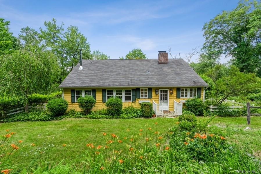 Make this verdant nature lovers paradise your home! This charming farm house located on historic Old