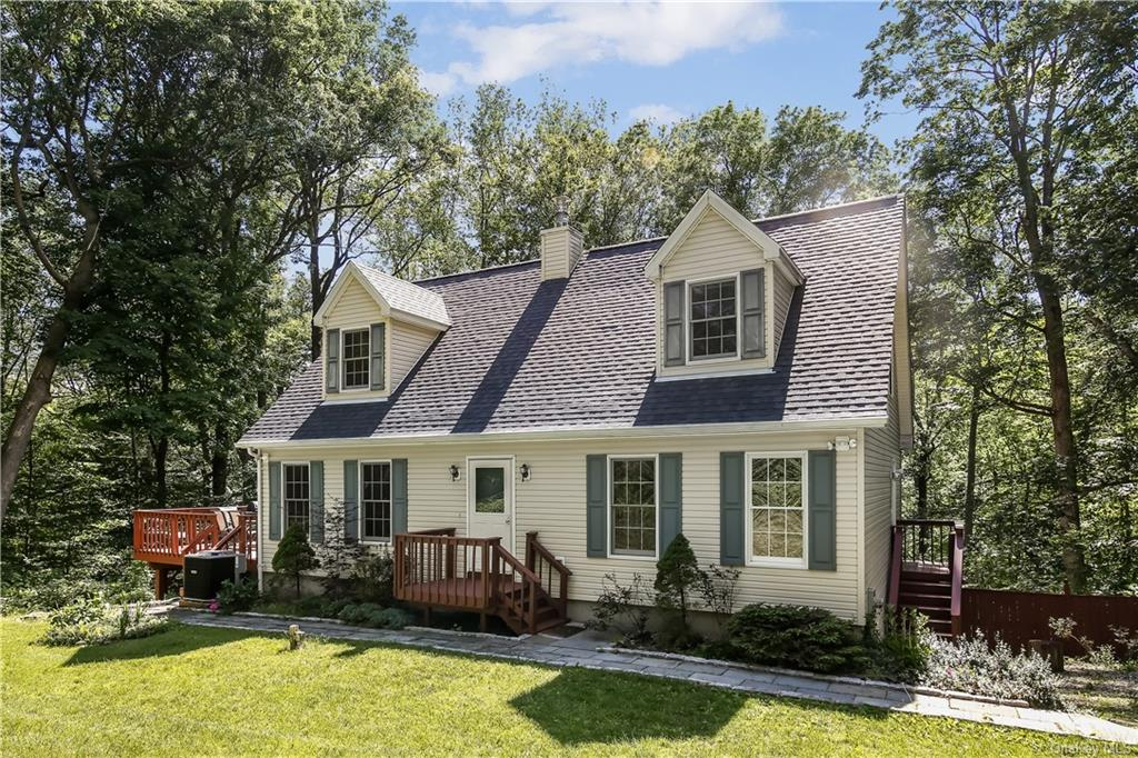 Escape to this charming Cape style home surrounded by nature. This home features hardwood flooring t