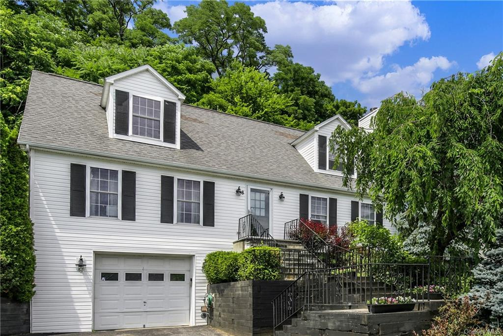 Welcome to this charming Cape Cod home which is spacious & bright offering 2058 square feet of livin